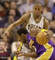 Indiana Pacers guard Reggie Miller puts the pressure on Los Angeles Lakers guard Kobe Bryant during the first quarter of their game at Conseco Fieldhouse in Indianapolis Ind. on Wednesday January 9 2002.