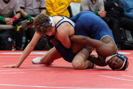Tyler Clay and Avery Porche in the final round of the Ken Cole Wrestling Tournament, Saturday, Jan. 25, 2020.