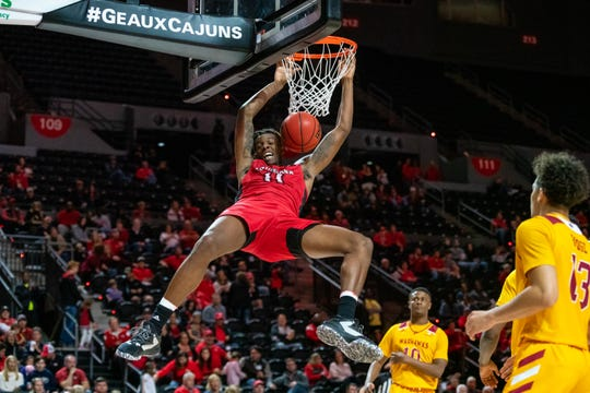 Tirus Smith dunks the ball home for two of his 11 points in UL's 81-60 win over UL Monroe on Saturday night at the Cajundome.