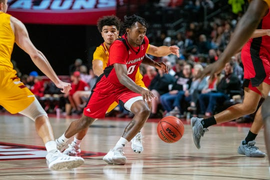 Junior guard Cedric Russell (0) returned from a foot injury to play in UL's win over UL Monroe last Saturday night at the Cajundome.