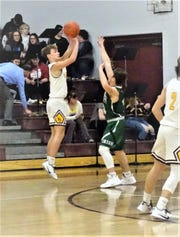 Berne Union's Levi Ross goes up for a shot against Fisher Catholic during the Rockets' 57-42 win Saturday night at Berne Union.