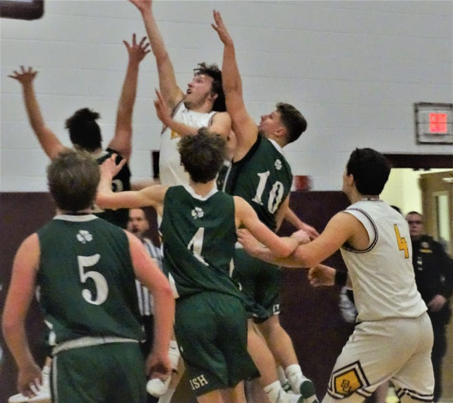 Berne Union's Chase McCartney goes up for two of his game-high 19 points during the Rockets' 57-42 win over Fisher Catholic Saturday night.