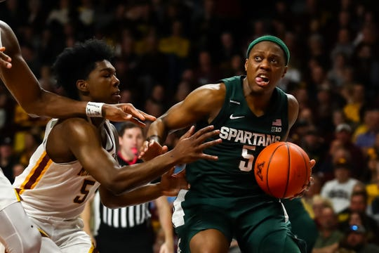 Michigan State's Cassius Winston drives to the basket against Minnesota's Marcus Carr in the second half Jan. 26, 2020 in Minneapolis.