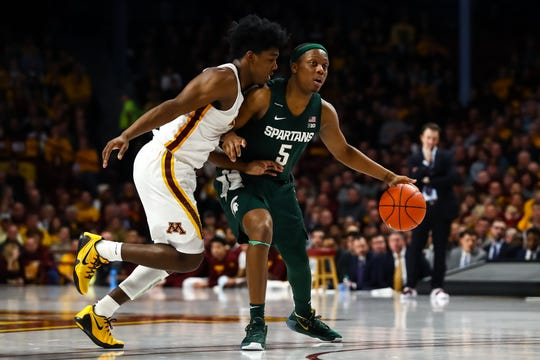 Jan 26, 2020; Minneapolis, Minnesota, USA; Michigan State Spartans guard Cassius Winston (5) dribbles the ball while Minnesota Golden Gophers guard Marcus Carr (5) defends in the second half at Williams Arena. Mandatory Credit: David Berding-USA TODAY Sports
