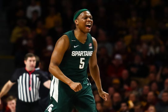 Jan 26, 2020; Minneapolis, Minnesota, USA; Michigan State Spartans guard Cassius Winston (5) reacts after hitting a three point shot against the Minnesota Golden Gophers in the first half at Williams Arena. Mandatory Credit: David Berding-USA TODAY Sports