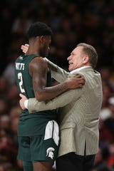 Michigan State head coach Tom Izzo, right, instructs player Rocket Watts during an NCAA college basketball game against Minnesota, Sunday, Jan. 26, 2020, in Minneapolis. (AP Photo/Stacy Bengs)