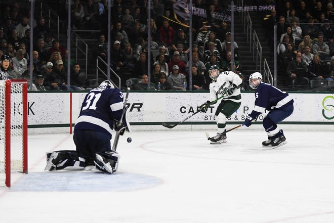 Michigan State defenseman Dennis Cesana takes a shot that was saved by Penn State goaltender Peyton Jones. The Spartans fell to the Nittany Lions 2-1 in overtime on January 25, 2020, at Munn Ice Arena