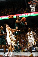 Michigan State's Aaron Henry goes up for a shot against Minnesota in the second half Jan. 26, 2020 in Minneapolis.