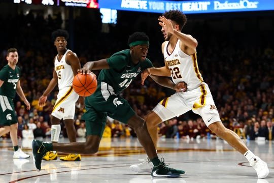 Jan 26, 2020; Minneapolis, Minnesota, USA; Michigan State Spartans forward Gabe Brown (44) dribbles the ball while Minnesota Golden Gophers guard Gabe Kalscheur (22) defends in the second half at Williams Arena. Mandatory Credit: David Berding-USA TODAY Sports