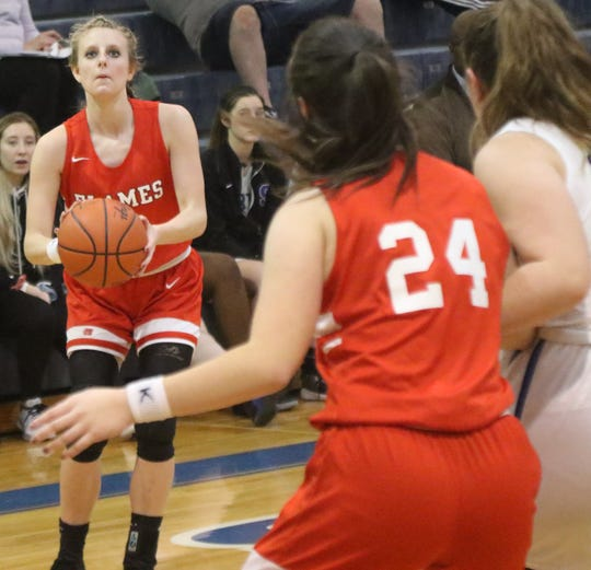 Mansfield Christian's Elle Schmitz provided the spark to lead the Lady Flames to a win over St. Peter's on Saturday.