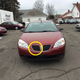Milwaukee police are looking for a maroon or red Pontiac G6, similar to this one, in connection with a hit-and-run crash that killed a man near Metcalfe Park.