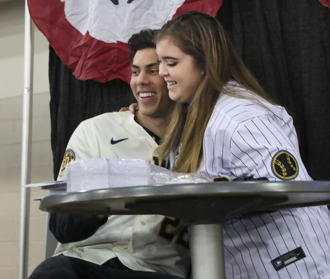 Christian Yelich gets a hug from Sarah Witherspoon of Oshkosh, during the Milwaukee Brewers' annual Brewers On Deck fan event at the Wisconsin Center on Sunday.