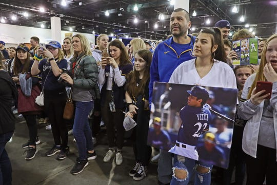 Admiring fans pushed in close to watch Christian Yelich sign autographs and photograph him during the Milwaukee Brewers annual Brewers On Deck fan event at the Wisconsin Center on Sunday.