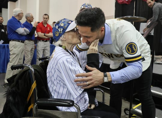 Ryan Braun of the Brewers gets a kiss on the cheek from Annette Moore, 83, of Brookfield, as Braun greeted her before he sat down for an autograph session with fans during the annual Brewers On Deck event at the Wisconsin Center on Sunday.