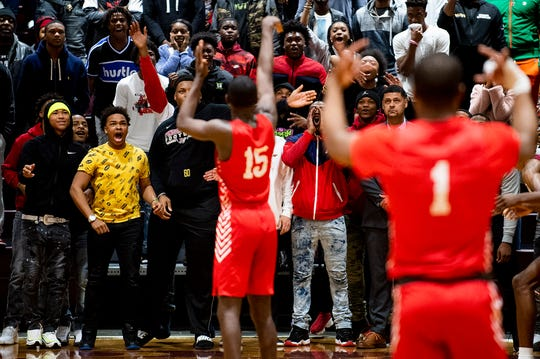 Pinson Valley fans try to distract Lee's De'Marquiese Miles (15) as he shoots free throws late at the Pinson Valley High School campus in Pinson, Ala., on Saturday January 25, 2020.