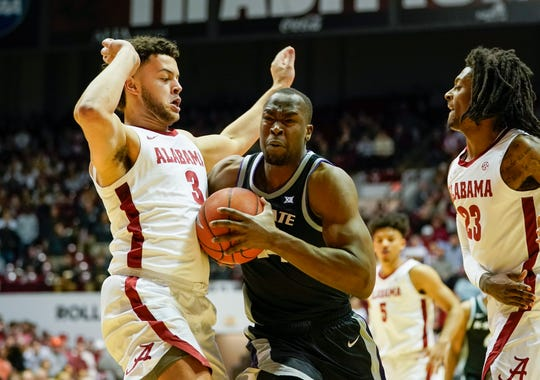 Jan 25, 2020; Tuscaloosa, Alabama, USA; Kansas State Wildcats forward Makol Mawien (14) drives to the basket against Alabama Crimson Tide forward Alex Reese (3) during the first half at Coleman Coliseum. Mandatory Credit: Marvin Gentry-USA TODAY Sports