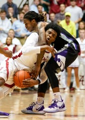 Jan 25, 2020; Tuscaloosa, Alabama, USA; Kansas State Wildcats guard Cartier Diarra (2) fouls Alabama Crimson Tide forward Herbert Jones (1) during the second half at Coleman Coliseum. Mandatory Credit: Marvin Gentry-USA TODAY Sports
