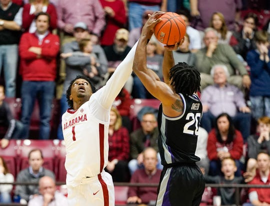 Jan 25, 2020; Tuscaloosa, Alabama, USA; Alabama Crimson Tide forward Herbert Jones (1) blocks a shot by Kansas State Wildcats forward Xavier Sneed (20) during the second half at Coleman Coliseum. Mandatory Credit: Marvin Gentry-USA TODAY Sports