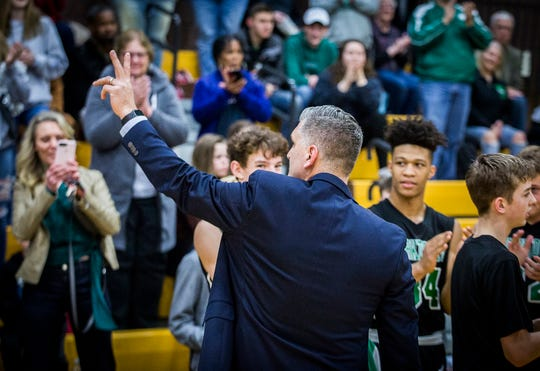 Yorktown head coach Matt Moulton is honored during his team's game against Monroe Central at Monroe Central High School Saturday, Jan. 25, 2020.