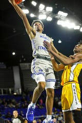 MTSU's Donovan Sims (3) drives to the basket against a Southern Miss defender on Saturday.