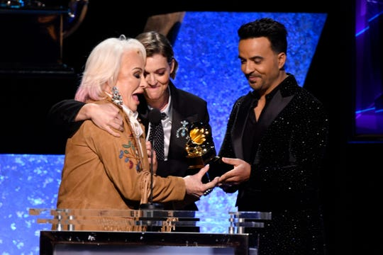 "Tanya Tucker (left)  joined by Brandi Carlile (center) accepts the award for best country album is announced for her album ""While I'm Livin"" from Luis Fonsi during the 62nd annual Grammy Awards."
