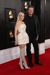 Gwen Stefani, left, and Blake Shelton arrive on the red carpet during the 62nd annual Grammy Awards on Jan. 26, 2020.