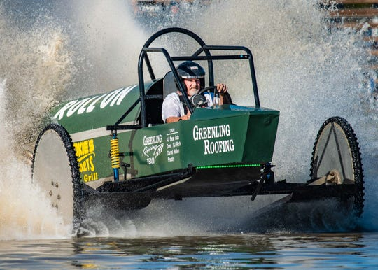 Dan Greenling, of Greenling Roofing, races to the finish line in Roll On, to win the Big Feature at the Swamp Buggy Races on Jan. 26 in Naples.