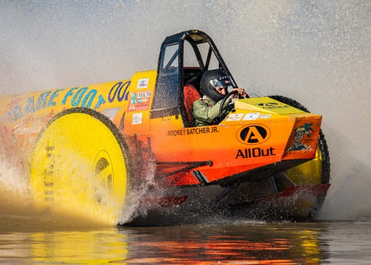 """""""Barefoot"""" Bobby Williams speeds to the finish line in Barefoot Florida Living to place second in the 2020 Swamp Buggy Winter Classic on Sunday. Williams won first place in the 2018 Fall Classic after this years' champion, Dan Greenling, stalled during the final race."""