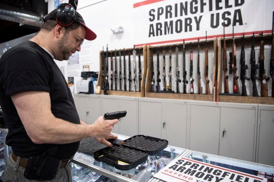 Russel Kelner does a safety check on his Glock 46X at Long Shot Pistol and Rifle in Secaucus on Saturday, January 25, 2020. Kelner is part of the Golani R&P Club.