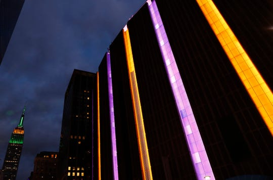 Jan 26, 2020; New York, New York, USA;  The exterior of Madison Square Garden is lit up in purple and gold, the colors of the Los Angeles Lakers, in memory of former Laker basketball star Kobe Bryant, who died in a helicopter crash today in Los Angeles, California. Mandatory Credit: Noah K. Murray-USA TODAY Sports