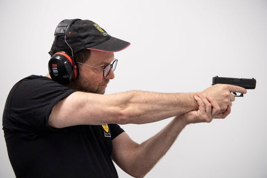 Russel Kelner poses for a portrait with his Glock 46X at Long Shot Pistol and Rifle in Secaucus on Saturday, January 25, 2020. Kelner is part of the Golani R&P Club.