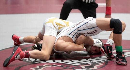 Palm Desert's Beau Mantanona pins Rancho Mirage's Kyle Tan during his win in the Desert Empire League wrestling finals in Rancho Mirage, Calif., on Saturday, January 25, 2020.