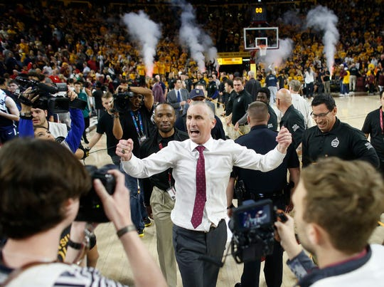 Arizona State Sun Devils head coach Bobby Hurley celebrates after beating the Arizona Wildcats 66-65 at Desert Financial Arena in Tempe, Ariz. on January 25, 2020.