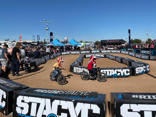 Future racers thrash dirt on a miniature supercross track Saturday at Monster Energy's FanFest, hours before the start of the first Triple-Crown event of the 2020 AMA Supercross racing season.