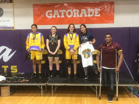 Jan. 25, 2020; Former ASU wrestler Anthony Robles (far right) stands next to the podium after handing out the medals to the fourth through first place girls in the 120-pound competition (left to right) Aaliyah Brown of Mesa, Grace Hendrickson of Basha, Neve Barragan of Mesa and champion Isabelle Munoz of Casteel