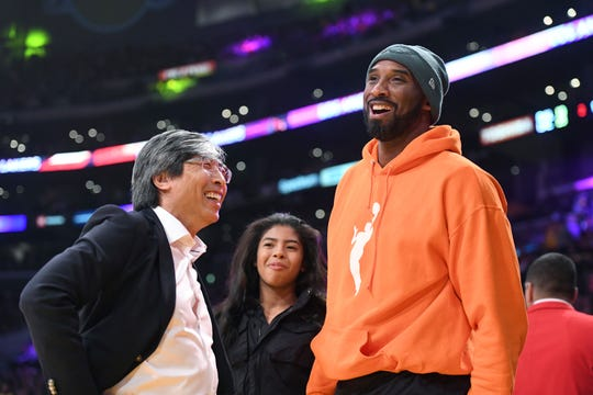 Patrick Soon-Shiong, left, talks with former Los Angeles Laker Kobe Bryant and Bryant's daughter Gianna Bryant at an NBA basketball game between the Los Angeles Lakers and Dallas Mavericks Sunday, Dec. 29, 2019, in Los Angeles.