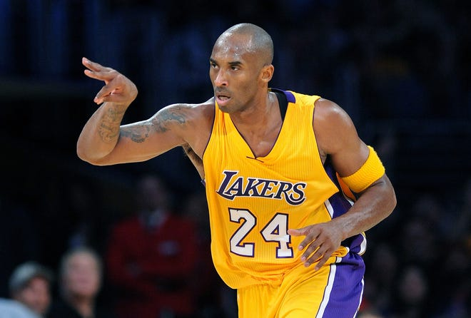 The Los Angeles Lakers' Kobe Bryant celebrates his 3-pointer against the Minnesota Timberwolves in the second quarter at Staples Center in Los Angeles on Wednesday, Oct. 28, 2015. (Wally Skalij/Los Angeles Times/TNS)