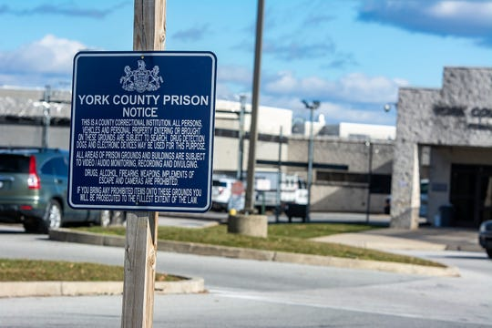 This sign posted at the entrance of York County Prison said cameras aren't allowed in prison buildings or on prison grounds. It says nothing about prohibiting filming from the public sidewalk.