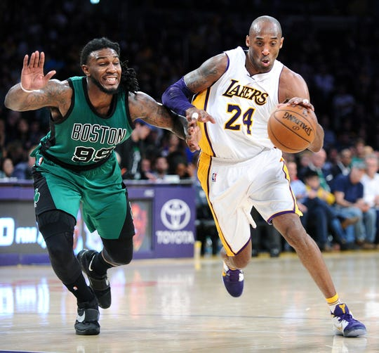 The Los Angeles Lakers' Kobe Bryant (24) drives past the Boston Celtics' Jae Crowder at Staples Center in Los Angeles on Sunday, April 3, 2016. The Celtics won, 107-100. (Wally Skalij/Los Angeles Times/TNS)