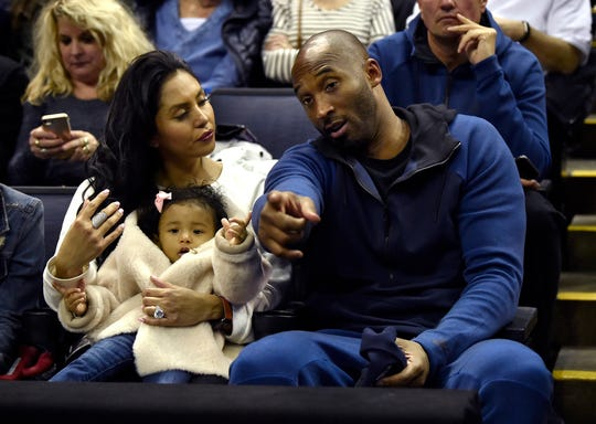 Kobe Bryant and his family prepare for the start of the UConn-Notre Dame NCAA Tournament national semifinal at Nationwide Arena in Columbus, Ohio, on Friday, March 30, 2018. Notre Dame advanced, 91-89, in overtime. (Brad Horrigan/Hartford Courant/TNS)