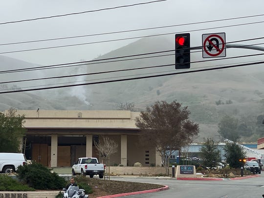 Smoke rises from the site of the helicopter crash Sunday morning, Jan. 26, 2020 in Calabasas, Calif. (Richard Winton/Los Angeles Times/TNS)