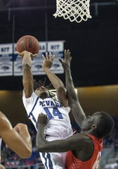 Nevada guard Lindsey Drew shoots over New Mexico's Makuach Maluach during the Wolf Pack's win Saturday night.