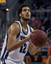 Nevada forward Johncarlos Reyes (12) shoots against New Mexico during the second half  at Lawlor Events Center on Saturday.