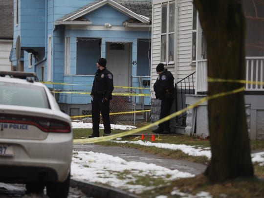 Two Rochester police officers stand in front of 108 Glendale Park, the home they responded to and from where the man who allegedly attacked them came out of.