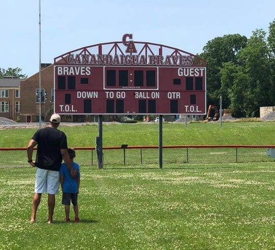 Ryan Poles visits Evans Field at Canandaigua Academy with his son Mason last summer.