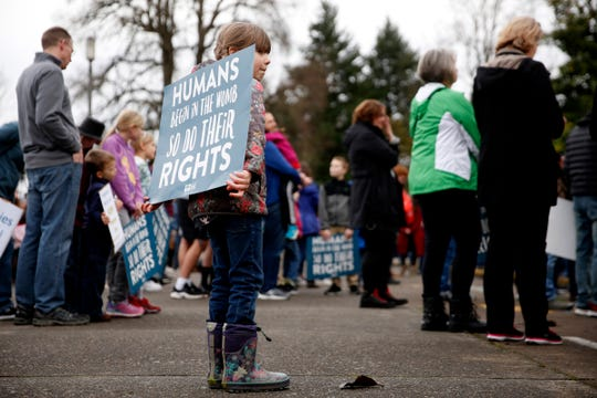 Gigi Kawell, 7, of Salem, carries a sign during the March for Life at the Oregon State Capitol in Salem on Jan. 25, 2020. To commemorate their 50th anniversary, Oregon Right to Life brought the event to back to Salem, its original home, after being in Portland for the past several years.