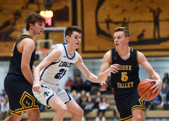 Sioux Valley's Max Nielson (5) dribbles toward the basket during the game against St. Thomas More on Saturday, Jan. 25, 2020 at the Corn Palace in Mitchell, S.D.