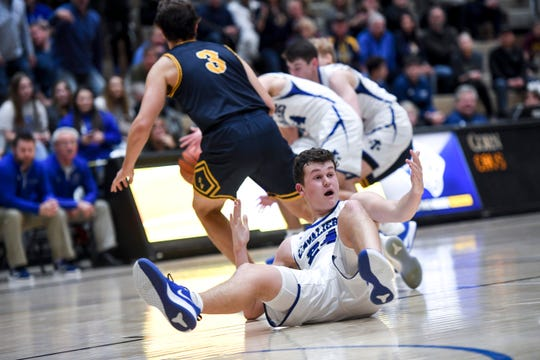 St. Thomas More's Ryder Kirsch (24) reacts to getting knocked down during the game against Sioux Valley on Saturday, Jan. 25, 2020 at the Corn Palace in Mitchell, S.D.