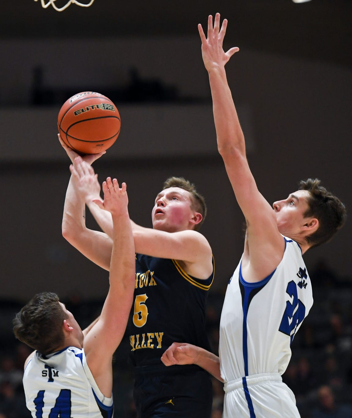 Sioux Valley's Max Nielson (5) goes up for a basket during the game against St. Thomas More on Saturday, Jan. 25, 2020 at the Corn Palace in Mitchell, S.D.