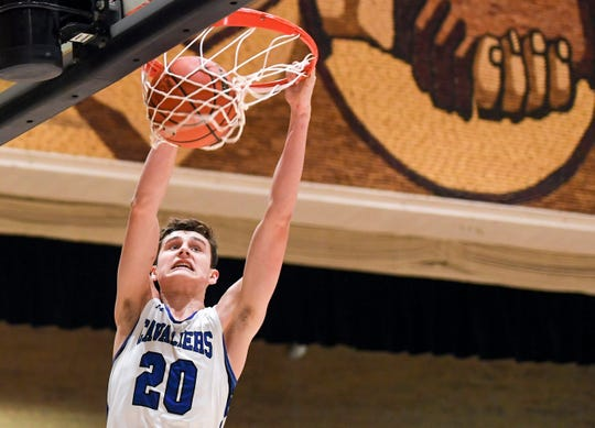 St. Thomas More's Connor Hollenbeck (20) dunks the ball during the game against Sioux Valley on Saturday, Jan. 25, 2020 at the Corn Palace in Mitchell, S.D.